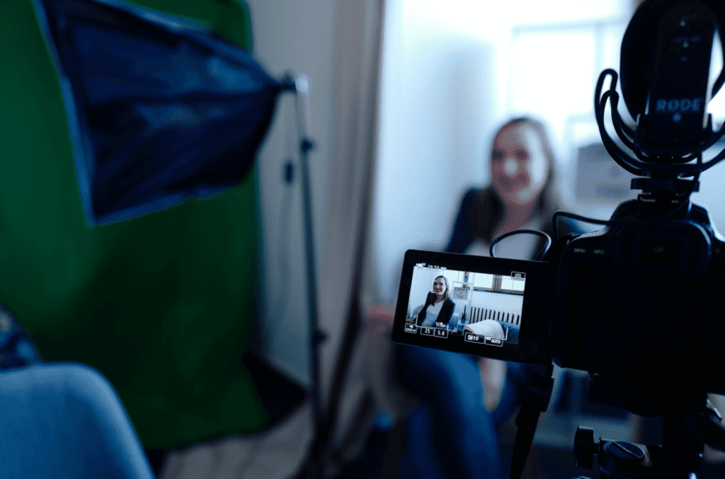 A person sitting down for an interview for their company's video marketing content.