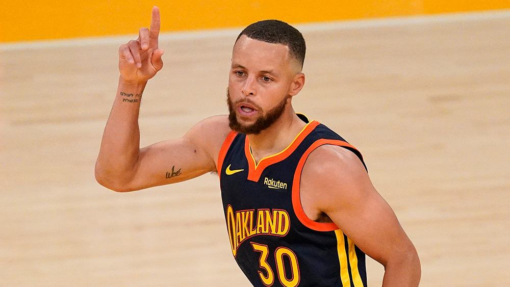 Steph Curry pointing to the sky